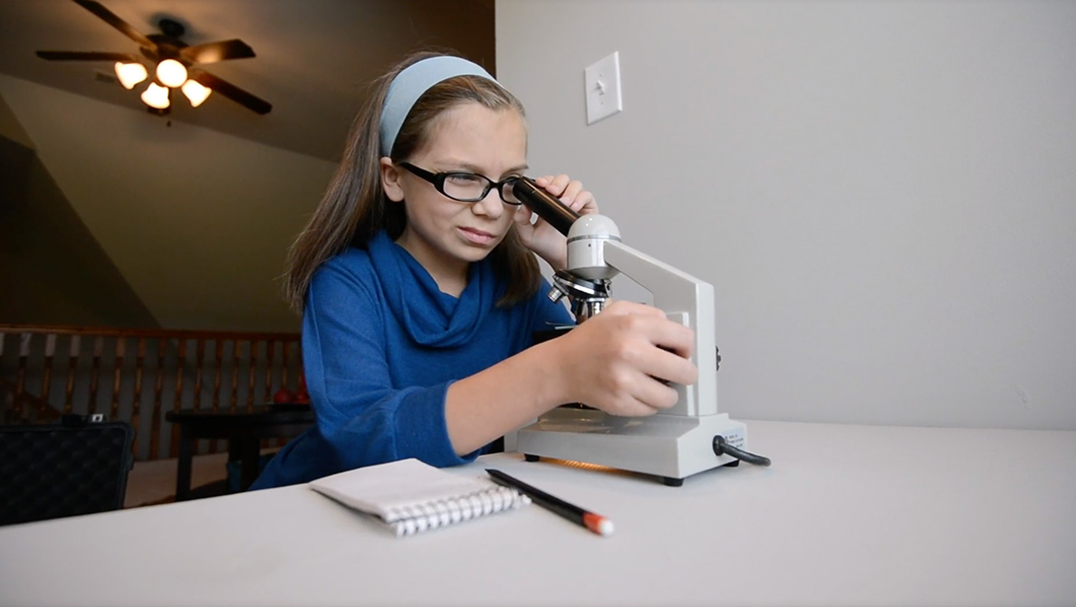 Student with microscope photo
